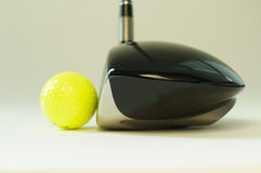 Golf club and ball. In a white background Stock Photos