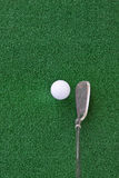 Golf club and ball on the artificial turf Stock Photos