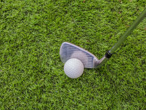 Golf club and ball on the artificial turf Royalty Free Stock Photos