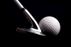 Golf club with ball on black background Royalty Free Stock Image