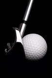 Golf club with ball on black background Stock Photos