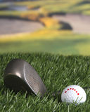 Golf club and ball on the fairway. Note the upside down happy face on the golf ball Royalty Free Stock Photo