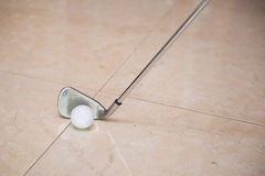 Golf club and ball on floor Royalty Free Stock Images