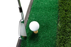 Golf club and ball. In grass Stock Images