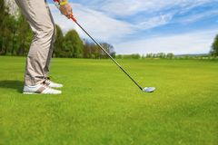 Golf club and ball in grass. Golf ball on grass in front of golf club Royalty Free Stock Photo
