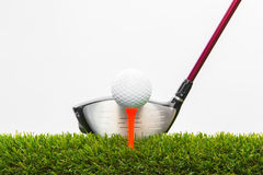 Golf club and ball in grass Royalty Free Stock Images
