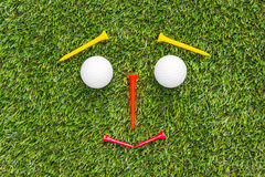Golf club and ball in grass Royalty Free Stock Image
