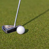 Golf club and ball. On the green Stock Photos