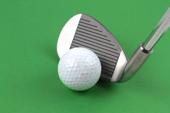 Golf club and ball. On green background Stock Image