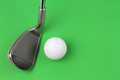 Golf club and ball. On green background Royalty Free Stock Photography