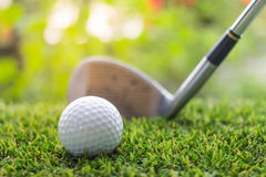 Golf club and ball on green grass Royalty Free Stock Photo