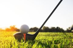Golf club and golf ball on green grass ready to play. royalty free stock photos