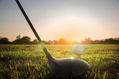 Golf club and golf ball on green grass ready to play. royalty free stock photography