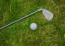 Golf club and ball. Lying on the green lawn Royalty Free Stock Images