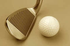 Golf club and ball sepia style image. Stock Image