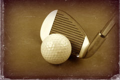 Golf club and ball sepia style image and worn photo paper effect. Stock Photography