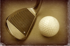 Golf club and ball sepia style image and worn photo paper effect. Stock Photos