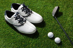 Golf club,ball and shoes Stock Photos
