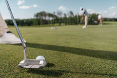 Golf club and ball before shot on green Royalty Free Stock Photo