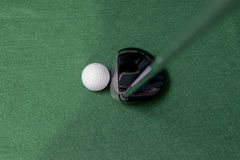 Golf club and ball. On a smooth green back ground Royalty Free Stock Photography