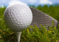 Golf club with ball on a tee Stock Images