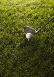 Golf club with ball on a tee Royalty Free Stock Images