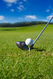 Golf club with ball on tee stock images