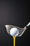 Golf club and ball on tee. Stock Photo