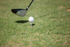 Golf club and ball before tee off Royalty Free Stock Photos