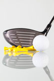 Golf club,ball and yellow tees on a glass table Stock Image