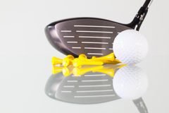 Golf club,ball and yellow tees on a glass table Royalty Free Stock Photography