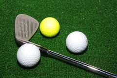 Golf club and balls. And on driving mat Stock Photo