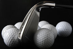 Golf club and balls. Golf club with golf balls in the black background Royalty Free Stock Images