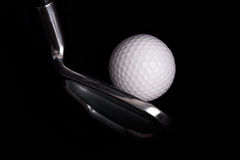 Golf club with balls on black background Stock Image
