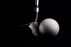 Golf club with balls on black background Stock Photo