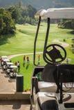 Golf club cars at golf field stock photo