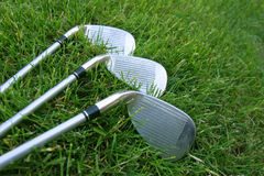 Golf Club Choices. Golf clubs in green grass Stock Images