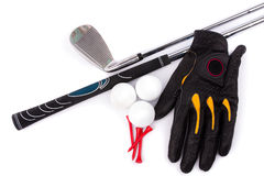 Golf club and glove with ball and tees on white background Stock Image