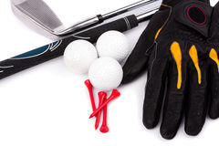 Golf club and glove with ball and tees on white background Royalty Free Stock Images