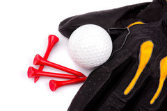 Golf club and glove with ball and tees on white background Stock Images