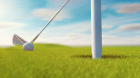 Golf club and golf ball on grass. Sunny day.  Stock Photography