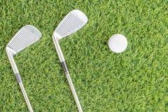 Golf club and golf ball on green grass Stock Photos
