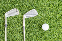 Golf club and Golf ball on green grass Royalty Free Stock Images