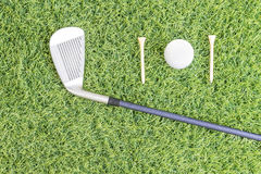 Golf club and golf ball on green grass Royalty Free Stock Photography