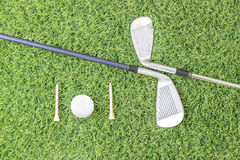 Golf club and golf ball on green grass Stock Photography
