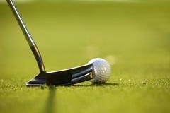 A golf club on a golf course Stock Photos
