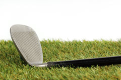 Golf club  on the grass Royalty Free Stock Image