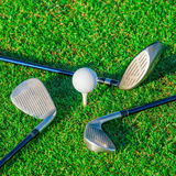Golf club. Green field and ball in grass Stock Photo