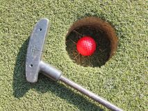 Golf club green grass golf field and ball in hole Royalty Free Stock Photos