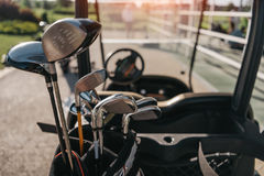Golf club heads in bag on the golf cart Stock Photos